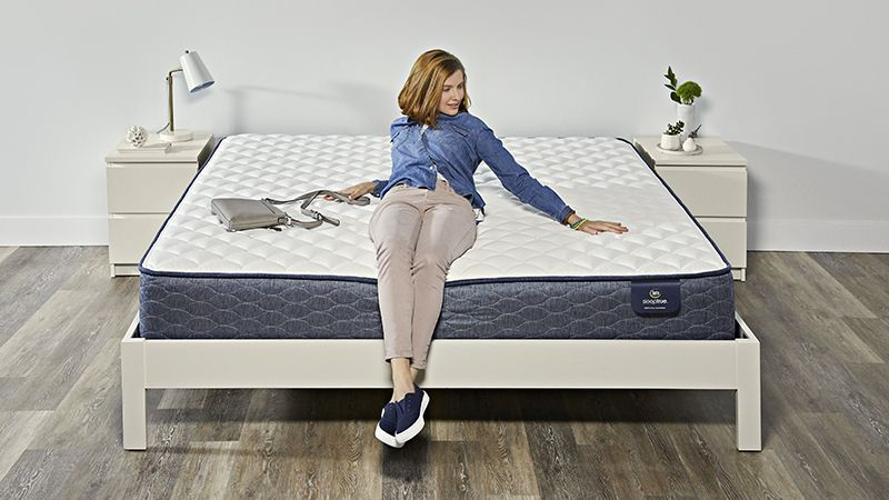 Hand pressing into a memory foam mattress