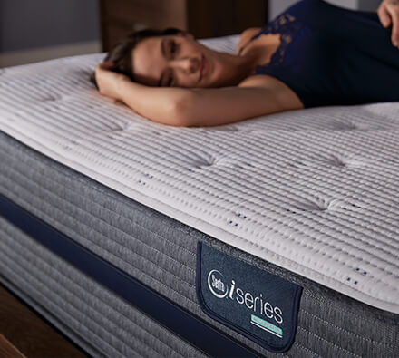 woman laying on iSeries Hybrid mattress