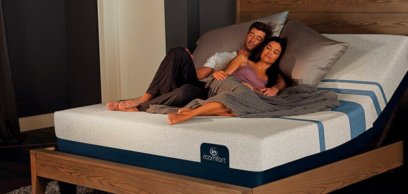 couple using adjustable foundation - Serta Bed Frame
